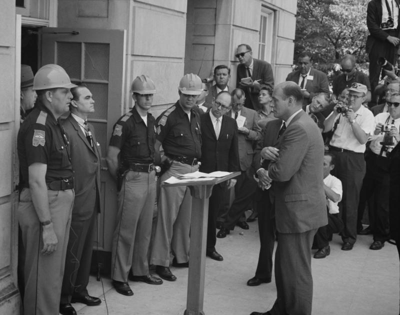 Gov. George Wallace, left, attempts to block integration at the University of Alabama on June 11, 1963.