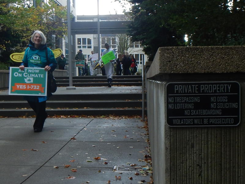 Cathy Carruthers of Tacoma and other costumed climate activists after being asked to leave Puget Sound Energy property.