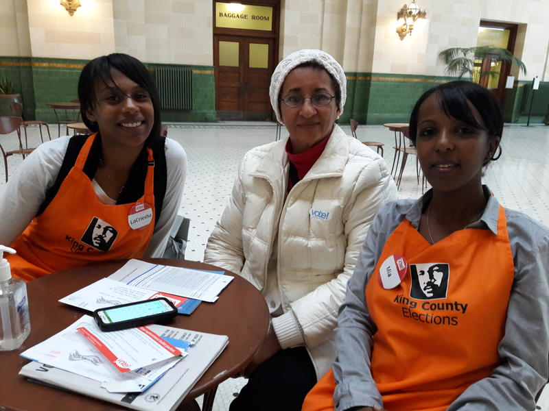 From left: LeCriesha Lewis, Elizabeth Haile and Mia Wolde-Maskell at the Seattle Union Station, one of the few in-person voting centers in King County.