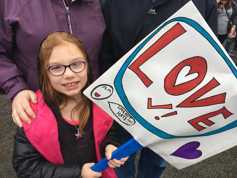 Lily Korhonen, 8, made her own sign for the rally.