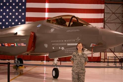 Air Force veteran Katherine Pratt in front of an F-35 Joint Strike Fighter. Pratt's detachment was responsible for the operational tests.