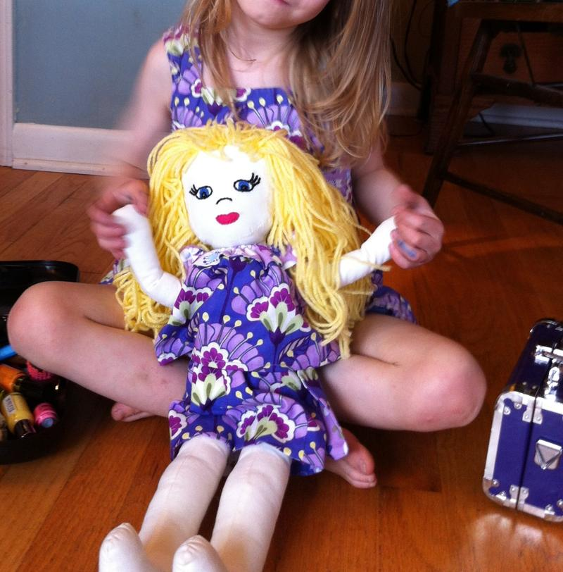 Marlo Mack's daughter with her baby doll.