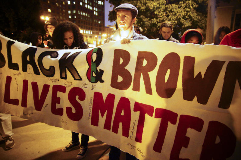 People take part in a 'Black Lives Matter' demonstration.
