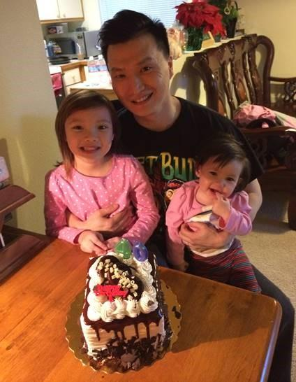Adam Crapser with two of his step-daughters.