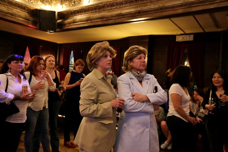 Beth Harrott, left, and Annabelle Richardson, watch the election results come in at The Century Ballroom. And yes, those are wigs (not their real hair) and pantsuits for Hillary, just to be clear.