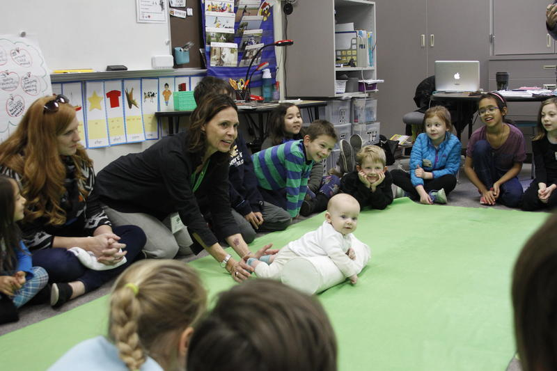 "Roots of Empathy instructor Rebecca Young and ""teacher"" baby Declan give a lesson at Highland Terrace Elementary School in Shoreline."
