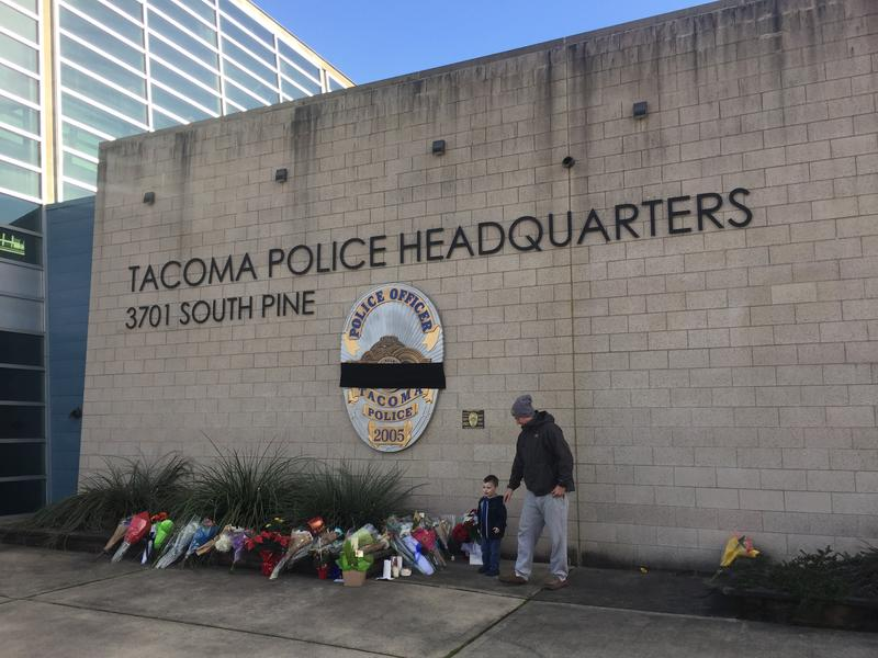 Chris Kerns and his son, Nolan, laid flowers in honor of the fallen Tacoma police officer on Thursday.
