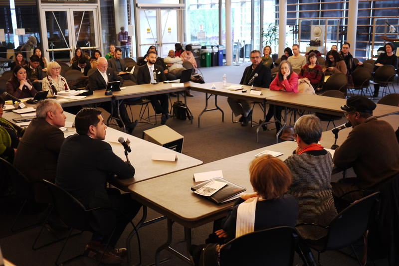 Seattle City Council members hold roundtable discussion with immigrant and refugee service providers.