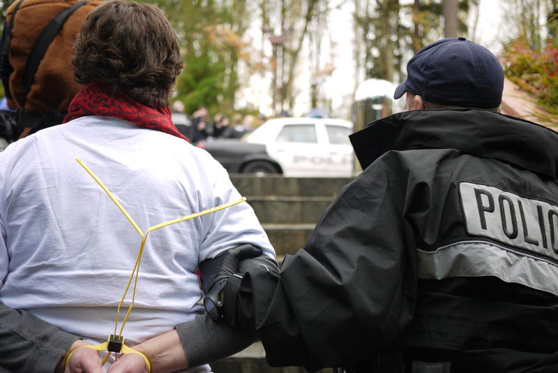 File photo, 2013. Police arrest protesters in Bellevue.