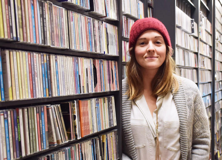 Brandi Carlile among the music collection at the KUOW studios.