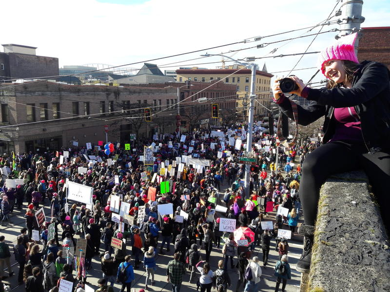 Elle Christensen watches the crowd for Seattle's women's march past her perch at Seventh and Jackson on Jan. 21.