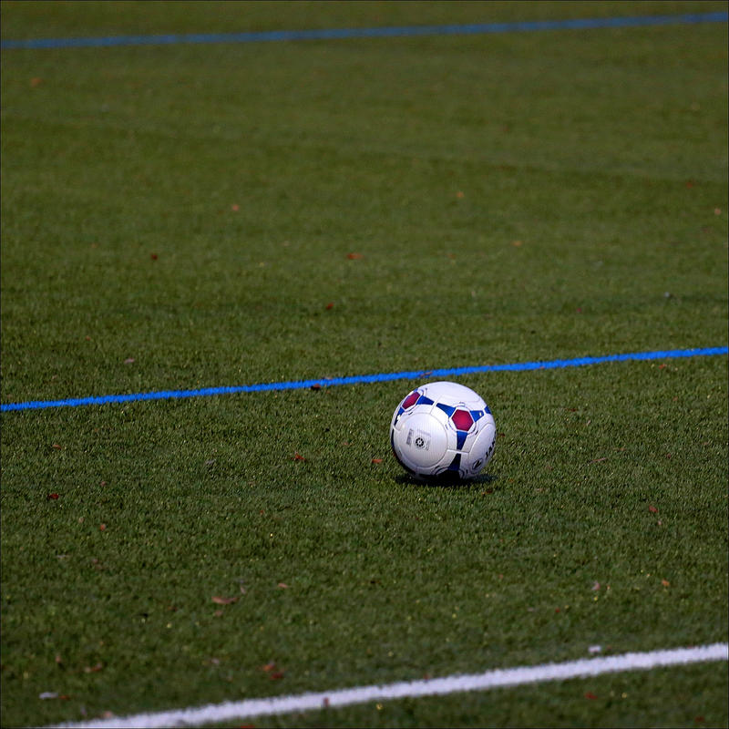 Soccer ball on artificial truf