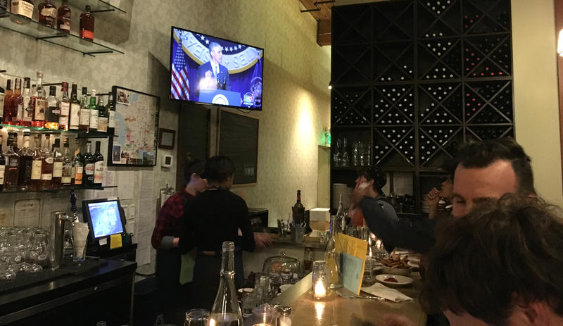 President Barack Obama's farewell address plays on the TV at Cafe Presse.