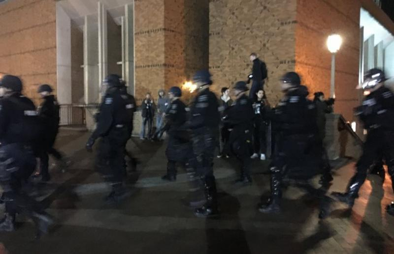 Police in riot gear on the University of Washington during protests Friday night.