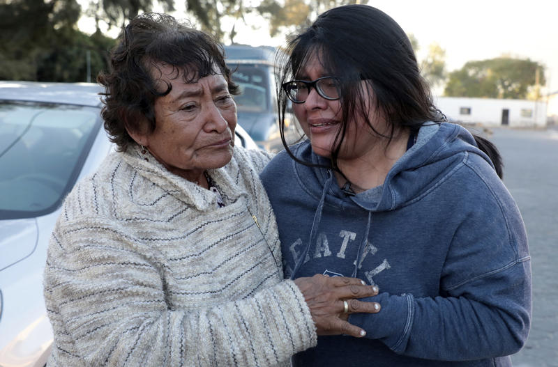 This Dec. 23, 2016 photo shows Tamara Alcala Dominguez reuniting with her grandmother Petra Bello Suarez in their home town of Molcaxac, Puebla state, Mexico, during Alcala's first return home since she left Mexico for the U.S. as a toddler.