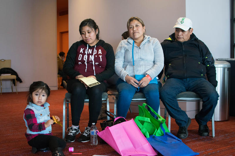 A family waits to speak with an immigration attorney at a free legal clinic hosted by the City of Seattle