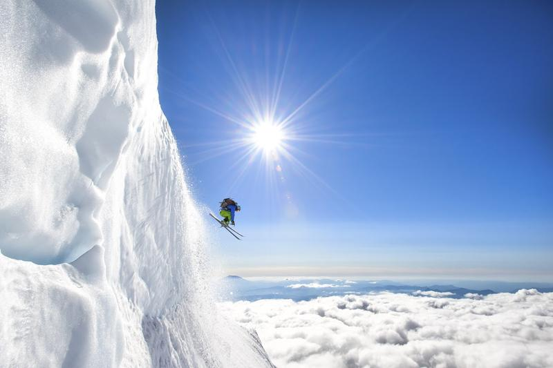 Jason Hummel photographs a skier making his way down Mt. Adams