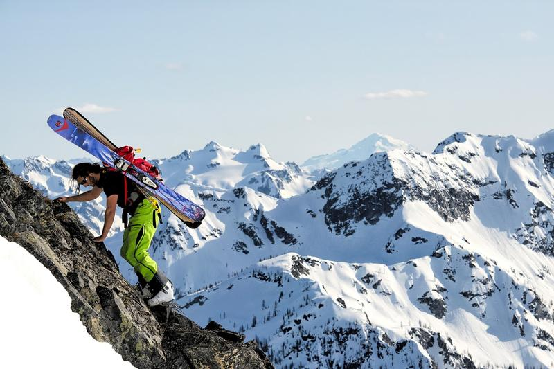 Jason Hummel photographs a backcountry skier making his way up a peak in the Cascades