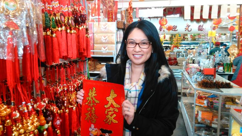 Leeching Tran with Lunar New Year decorations at Viet Wah Supermarket. She's worried the Womxn's March on Seattle will mean fewer sales
