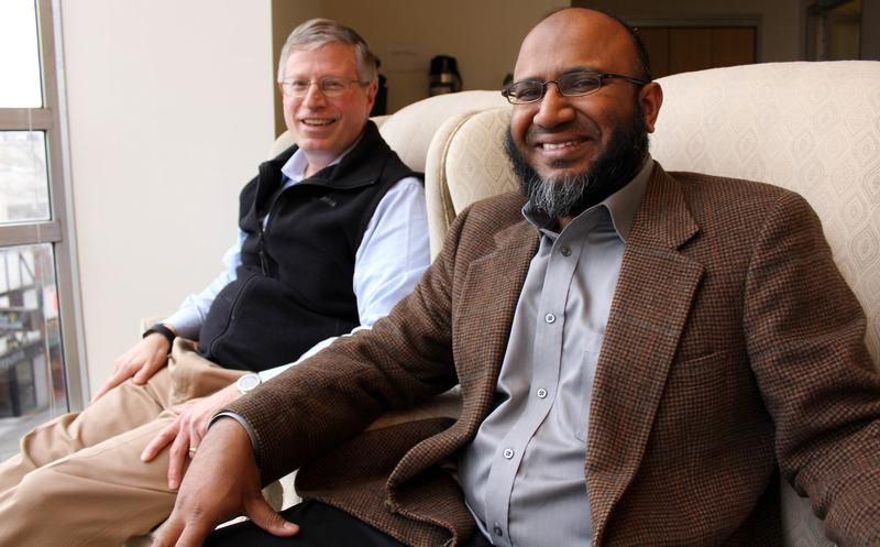 Gordon Wilson sits next to Tanvir Rahman at the KUOW Studios.