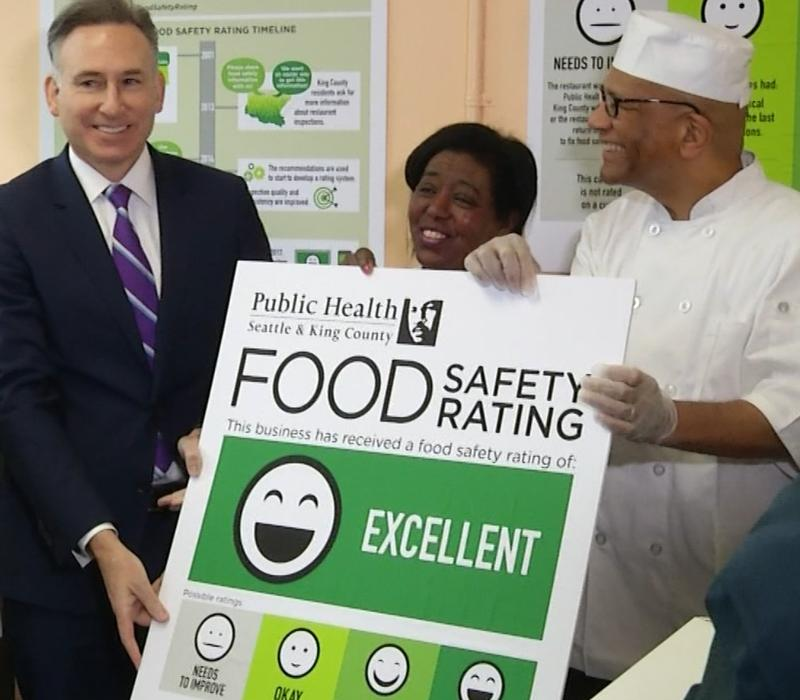 King County executive Dow Constantine presents West Seattle Fish House with an 'excellent' food safety rating.