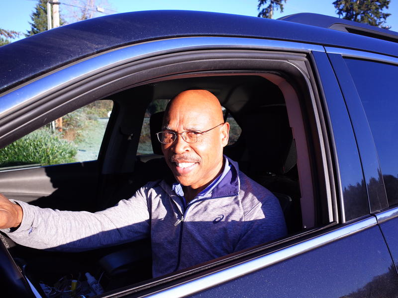 State Representative John Lovick in his car. The former state trooper and Snohomish County Executive offered to drive a reporter around in the early morning to demonstrate a particular form of suffering felt by commuters North of Seattle.