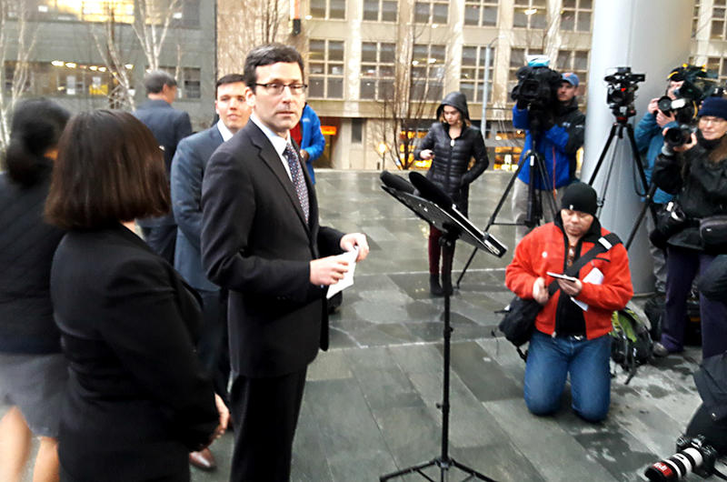 Washington Attorney General Bob Ferguson prepares to talk to the media about a federal judge's ruling on the Trump refugee order Friday, Feb. 3, 2017.