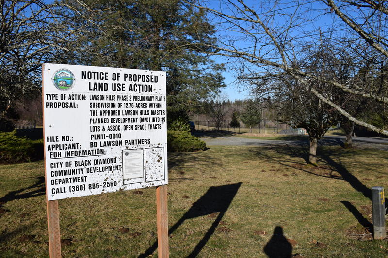 Notice of Proposed Land Use Action signs are ubiquitous in Black Diamond. The planned development will eventually bring 6,000 new homes to the area.
