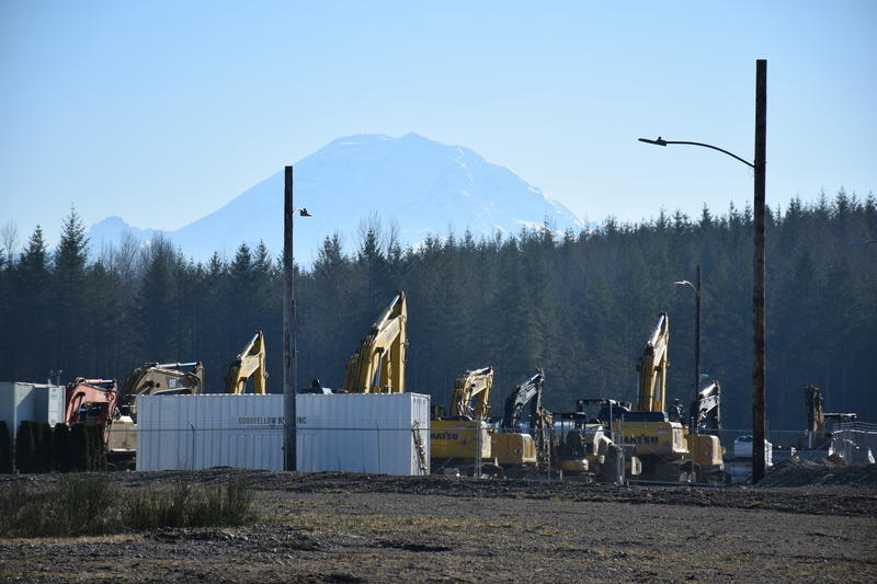 Mount Rainier looms behind the site of the Oakpointe development in Black Diamond, Washington.