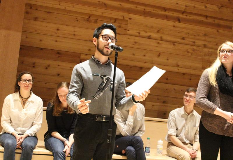 UW student Mack Ikeru reading stories from the Vulnerability Collective