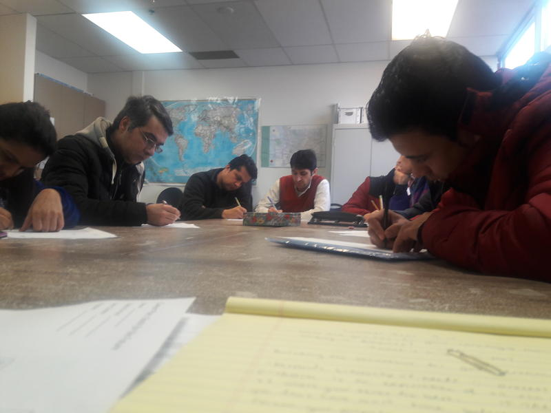 Refugees write down their plans for finding work at World Relief's jobs class. They have four months to find a job after arrival.
