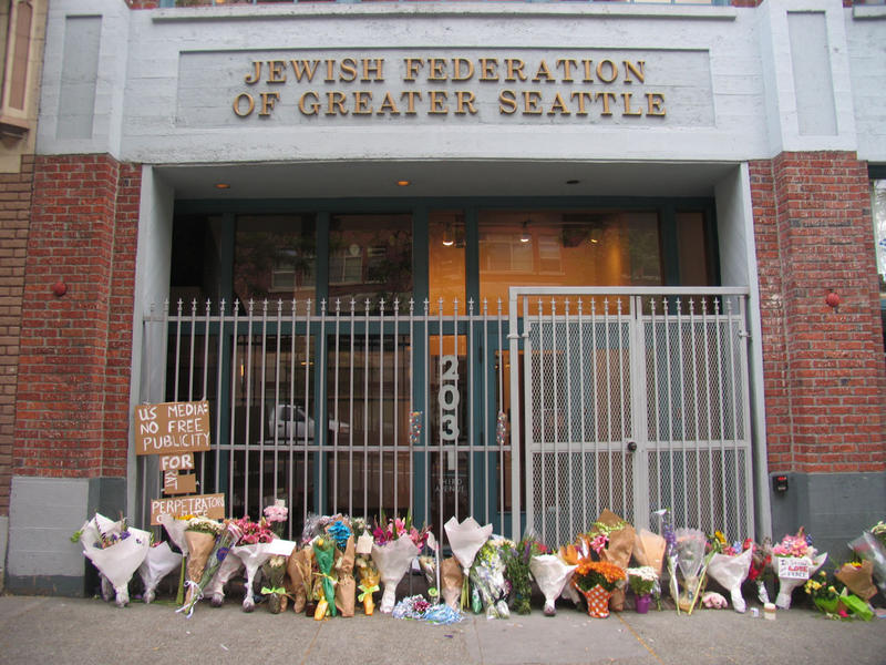 Flowers outside Jewish Federation Building commemorate the 2006 hate-crime shooting .