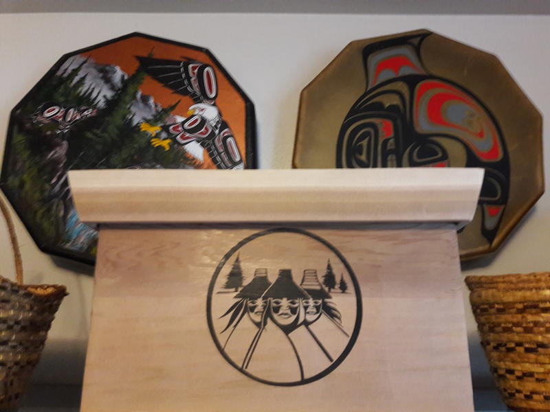 A cedar box with a painting of three sisters that the Nooksack tribe says were erroneously enrolled decades ago. Nearly 300 people descend from these three sisters.
