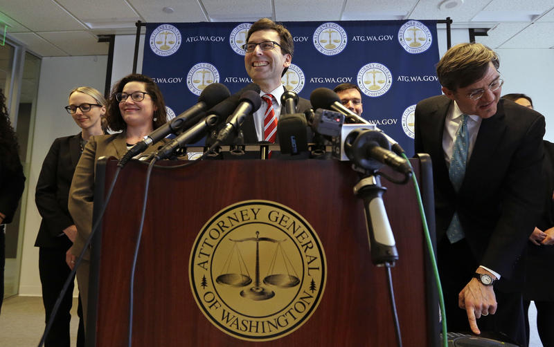 Washington state Attorney General Bob Ferguson smiles during a news conference about President Trump's new executive order Monday, March 6, 2017, in Seattle. The new ban, which takes effect March 16, halts travel for 90 days for residents of Iran, Libya,