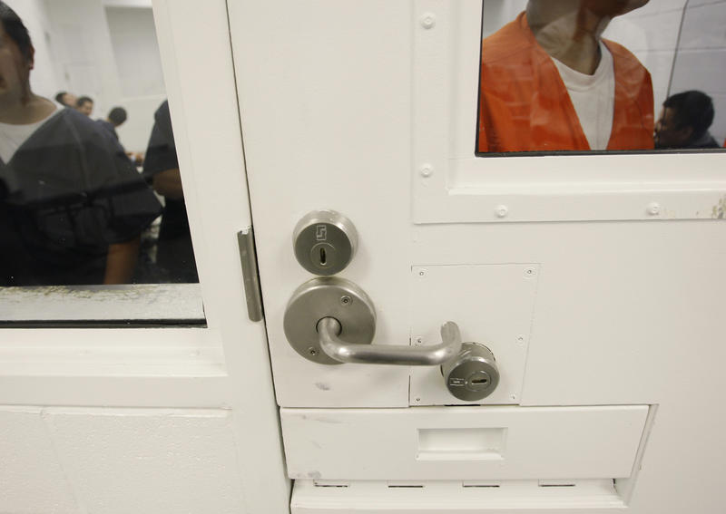 Detainees are shown inside a holding cell at the Northwest Detention Center in Tacoma, Wash., Friday, Oct. 17, 2008.