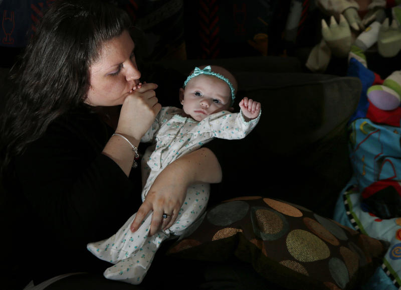Jennifer Fontaine kisses her daughter Morgan in Methuen, Massachusetts on Tuesday, Feb. 25, 2014. After Fontaine's standard prenatal screening suggested her fetus might have Edwards syndrome, a doctor suggested a fetal DNA test, which said she was fine.