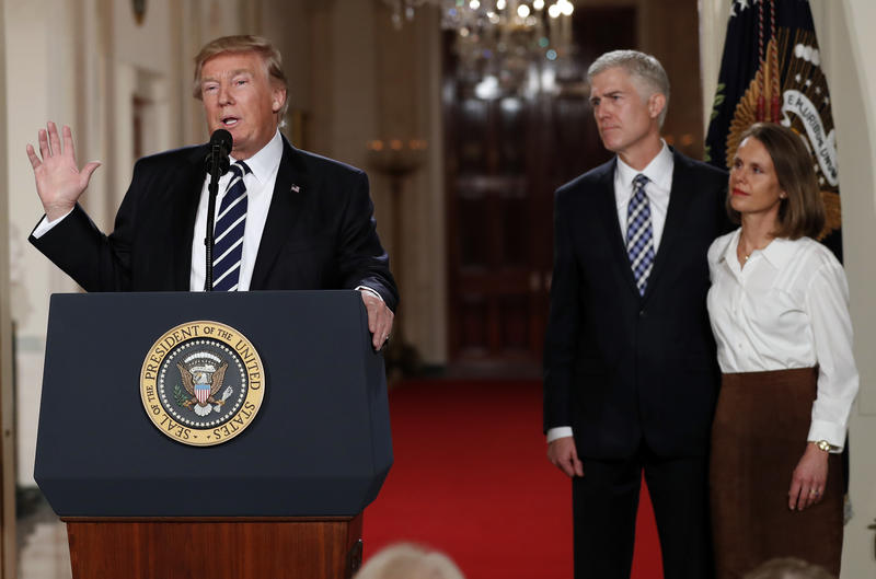 President Donald Trump speaks in the East Room of the White House in Washington, Tuesday, Jan. 31, 2017, to announce Judge Neil Gorsuch as his nominee for the Supreme Court. Gorsuch stands with his wife Louise.