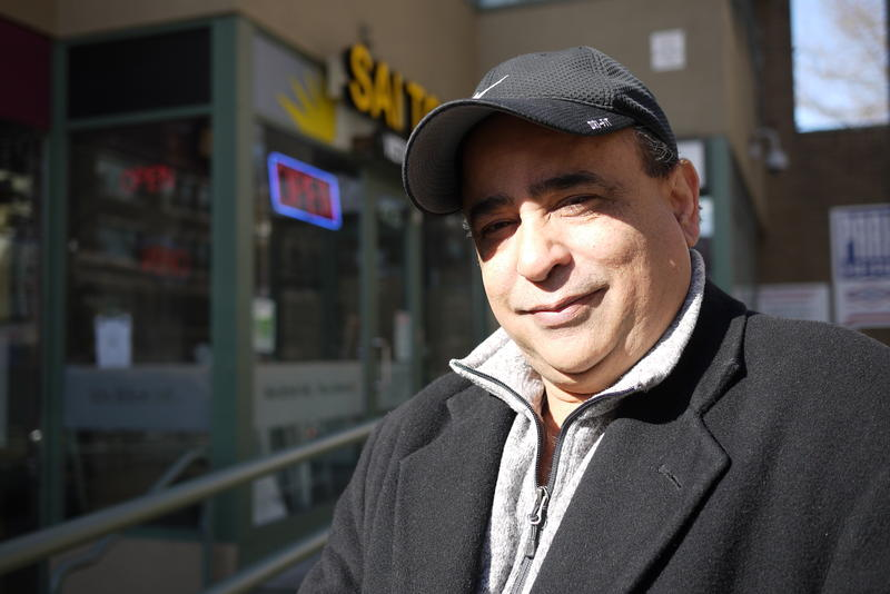 Rizwan Samad, president New Wave Travel, outside his Seattle office.