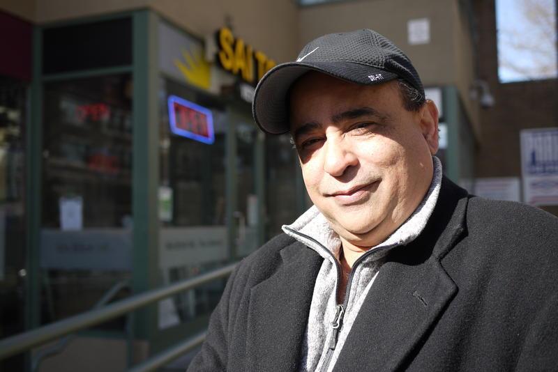 Rizwan Samad, president New Wave Travel, outside his Seattle office.