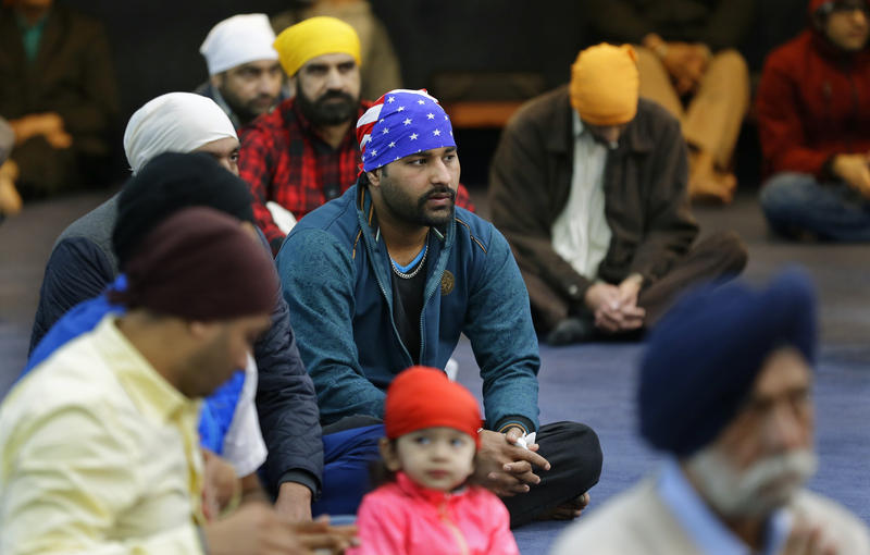 Men attend Sunday services at the Gurudwara Singh Sabha of Washington, a Sikh temple in Renton, Wash., Sunday, March 5, 2017, south of Seattle.