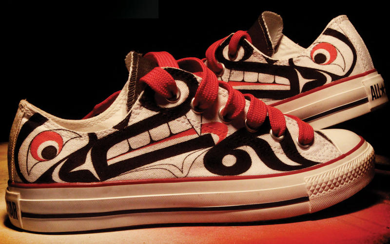 Athletic shoes, hand decorated by Louie Gong