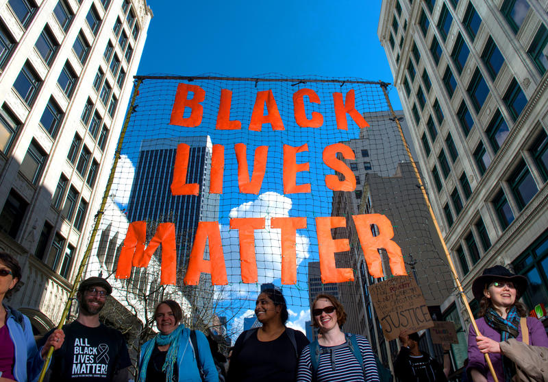 Marchers held signs at the Black Lives Matter rally in Seattle on Saturday, April 15, 2017.