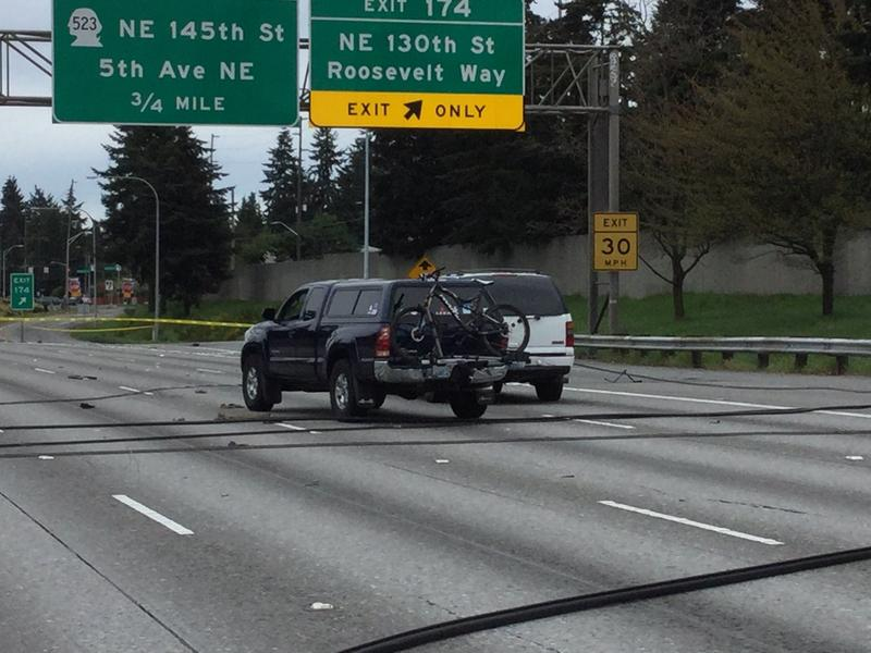 Two SUVs trapped between live power wires on Interstate 5 on Saturday morning.