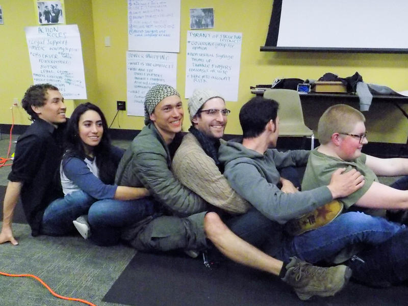 One blockade called the caterpillar – a line of people sitting almost in each other's laps with arms and legs intertwined – led to awkward body contact and laughter among the volunteers trying it.