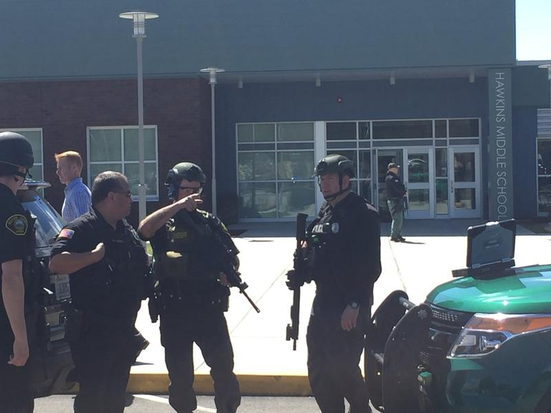 Officers from multiple agencies clearing Hawkins Middle School after reports of a shooter.