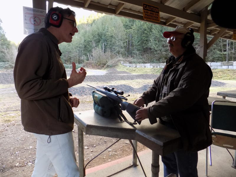 KUOW host Bill Radke speaks with journalist and gun advocate Dave Workman at a gun range