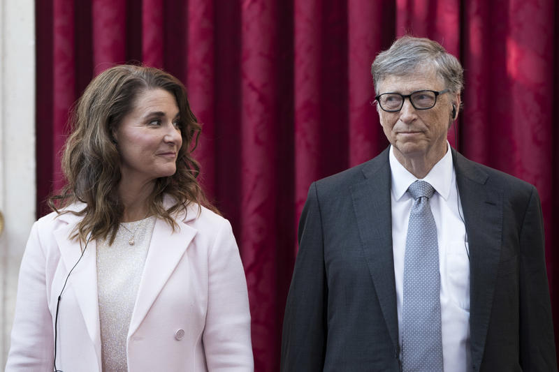 Philanthropist and co-founder of Microsoft, Bill Gates, right, and his wife Melinda listen to the speech of France's President Francois Hollande, prior to being awarded of the Legion of Honour at the Elysee Palace in Paris, Friday, April 21, 2017.