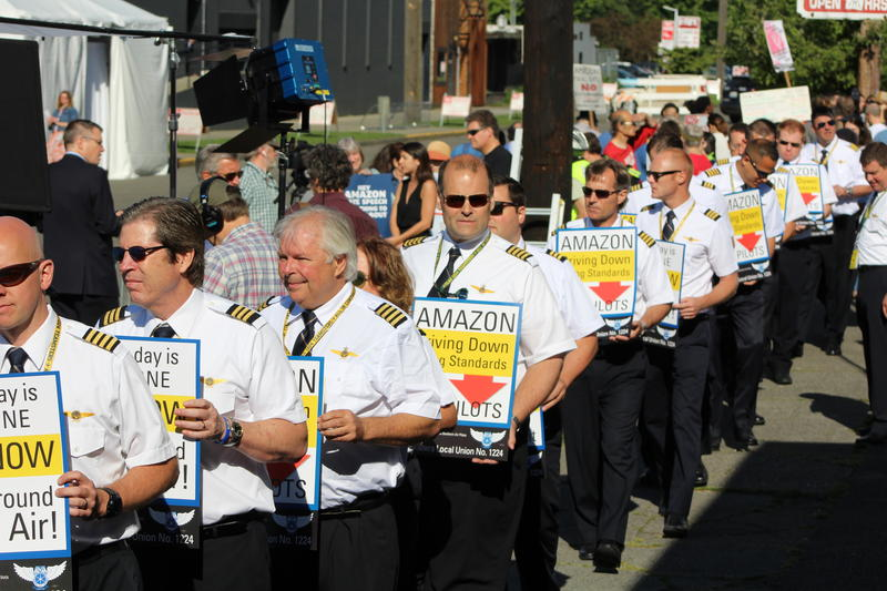 Pilots for Amazon Prime Air carriers protest outside an annual Amazon meeting in Seattle