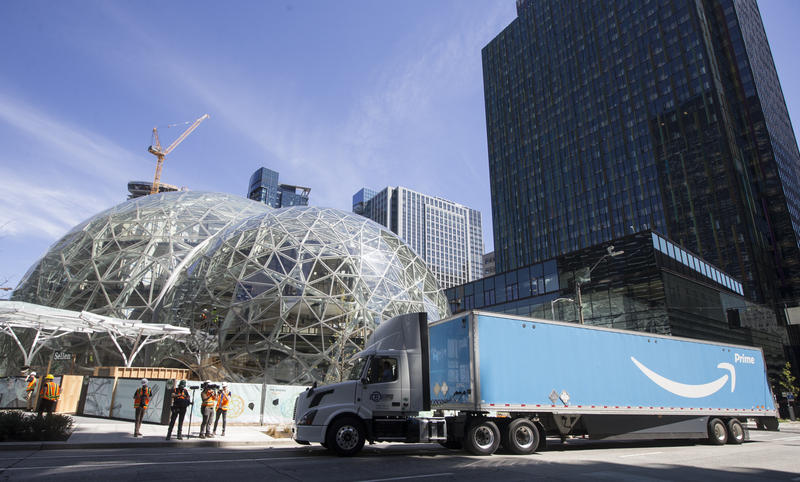 An Amazon Prime truck delivers an Australian fern to Amazon's campus for the ceremonial first planting at The Spheres on Thursday,  May 4, 2017, in Seattle.