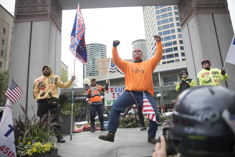 Tusitala Toese of Vancouver, Wash., performs a War Dance from his American Samoa, where he's from, during a pro-Trump rally at Westlake Plaza in downtown Seattle on Monday, May 1, 2017.
